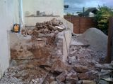 Demolishing steps and patio in Woodford Ave